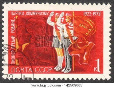 MOSCOW RUSSIA - CIRCA APRIL 2016: a post stamp printed in the USSR shows pioneers the series