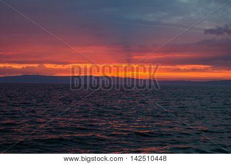 Cloudy sunset on sea on Cres Island in Croatia