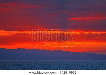 Dramatic cloudy sunset on sea on Cres Island in Croatia