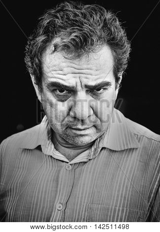 Black and white portrait of an aggressive man