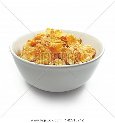 Cornflakes in a white bowl, breakfast. Isolated on white.