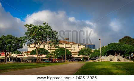 Honolulu, Hawaii, USA - Dec 21, 2015: Ala Moana Shopping Center viewed from the Ala Moana public park. Image shows a cloudscape that was fast changing.