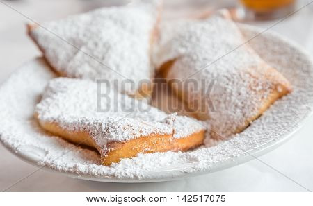 Beignets on a Plate with powdered sugar
