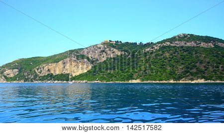 View On A Coast With A Mountain Chain And A Buildung On The Top On The Island Corfu (town Afionas)