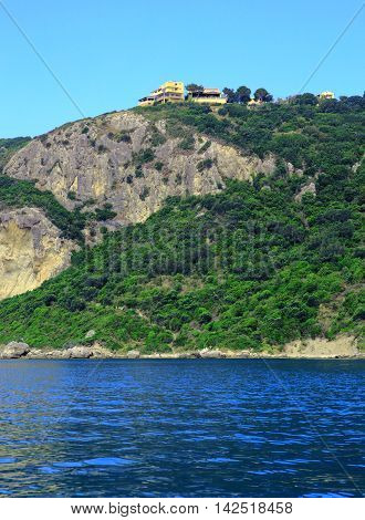 View On The Coast With A Mountain Chain And A Buildung On The Top On The Island Corfu (town Afionas)