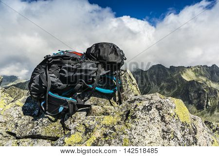 Black Backpack In The Mountains.