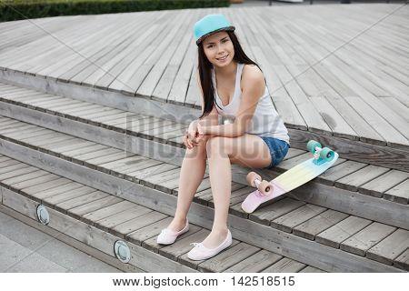 Young Girl With Short Cruiser Skateboard Deck Outdoors