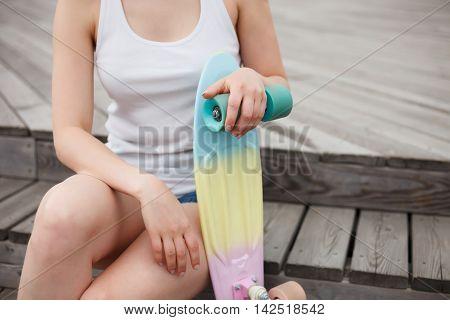 Girl Holds Colorful Short Cruiser Skateboard Deck