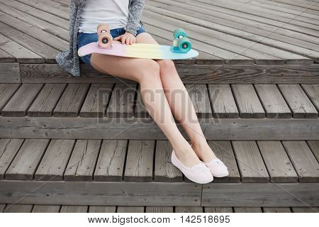 Legs Of Girl With Colorful Short Cruiser Skateboard
