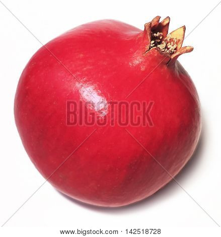Fresh, pink colored pomegranate, isolated on white background.