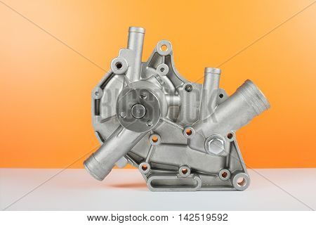 Car Parts - Automobile water pump classic on an orange background