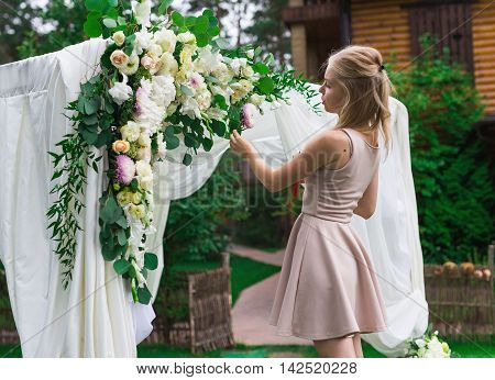 Decorator Working With Flowers Composition For Wedding Arch.
