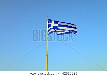 greece country pole flag over blue sky