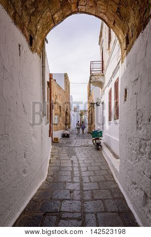 Traditional street with white houses in Lindos village, Rhodes island, Dodecanese, Greece.