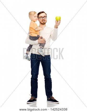 family, childhood, fatherhood, healthy eating and people concept - happy father and and little son with green apple
