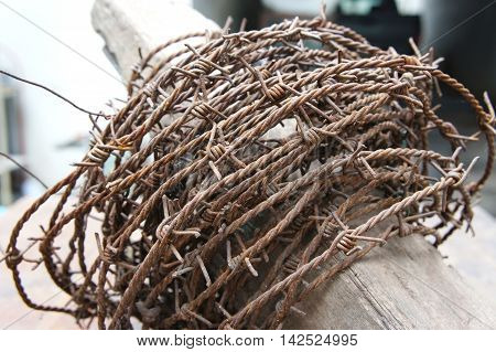 The Barbed wire rusty ,Device used to prevent poaching. Tell them of the territory