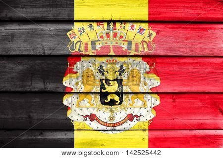 Flag Of Belgium With Coat Of Arms, Painted On Old Wood Plank Background