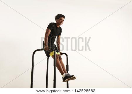 Young Black Man Doing L-sits On Short Bars