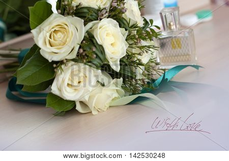 Postcard LOVE holiday, bridal bouquet, wedding, flowers, white roses and perfume on the dressing table and a white tulle
