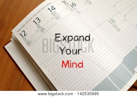 Expand your mind text concept write on notebook