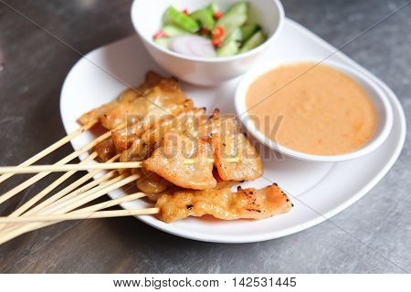 Pork satayGrilled pork served with peanut sauce or sweet and sour sauce