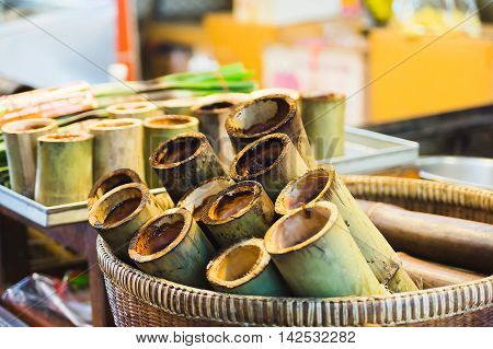 Cylinder Lam (Sticky rice in bamboo) in basket