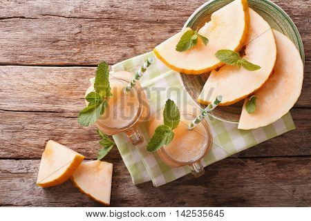 Honeydew Melon Juice Closeup On Wooden Background, Horizontal Top View