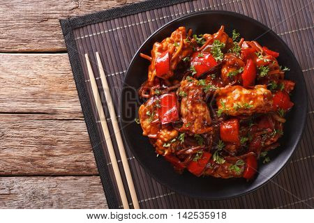 Pork Braised In Sweet And Sour Sauce With Vegetables Close-up. Horizontal Top View