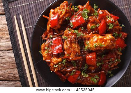 Chinese Food: Pork In Sauce With Vegetables On A Plate. Horizontal Top View