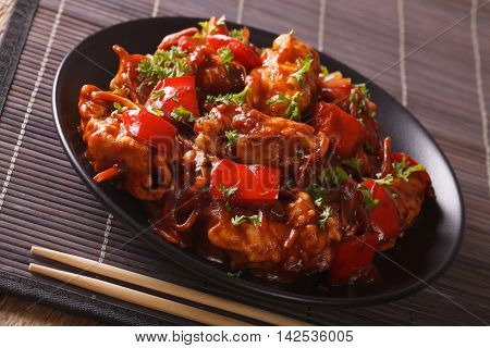 Roasted Pork With Vegetables In Sour-sweet Sauce Close-up. Horizontal