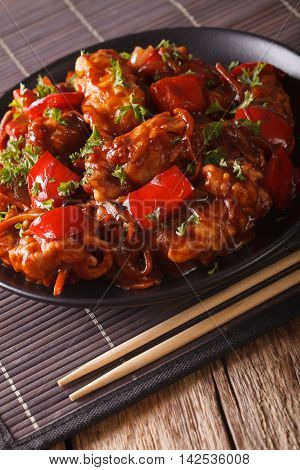Asian Food: Spicy Pork In Sweet And Sour Sauce Close-up. Vertical