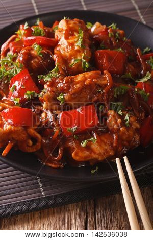 Pork Roast With Peppers, Carrots And Onions In Sweet And Sour Sauce Close-up. Vertical