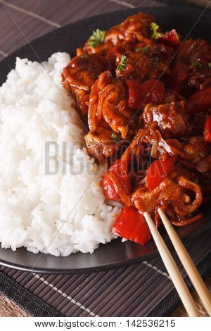 Chinese Food: Pork In Sweet And Sour Sauce With Rice Close-up. Vertical