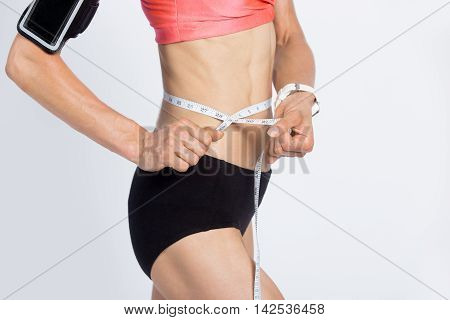 Fitness Girl Measuring Her Waist