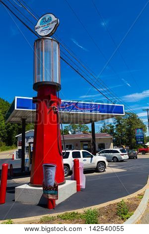 Troy PA - July 26 2016: Outside B&S convenience store a modernized gas station on Route 6 west of Troy stands a large old-fashioned glass bowl gas pump.