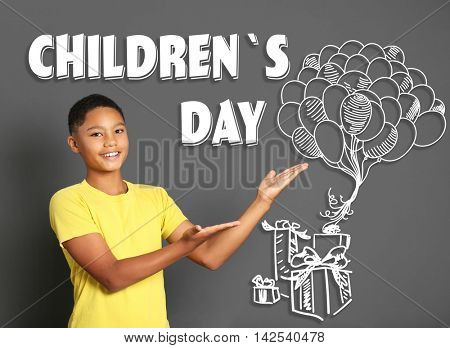 Cute afro american teenager and text children's day on gray background. Children's day concept.