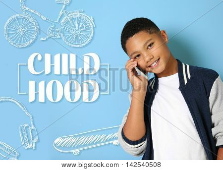 Cute afro american teenager and text childhood on blue background. Childhood concept.