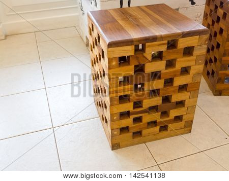 The chair is made of small pieces of wood. on the table in coffee shops.