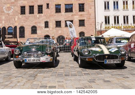 Nurnberg Bavaria / Germany - July 19th 2014: green Austin-Healey 3000 MK II and Jaguar E Type at Sud - Rallye- Historic event in Nurnberg