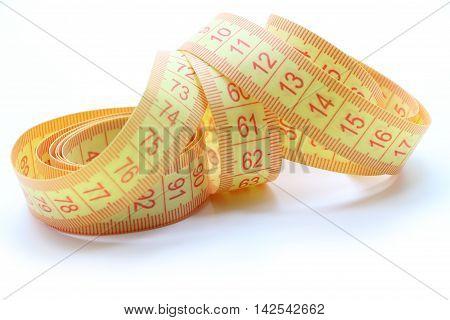Yellow centimeter tape. Close up. White background