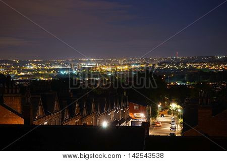 A dramatic night view over rooftops in Leeds