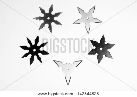 Five different shurikens are on white background.