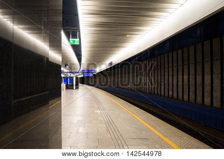 Empty train platform extending off into the distance