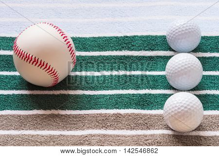 balls on a striped background golf and baseball