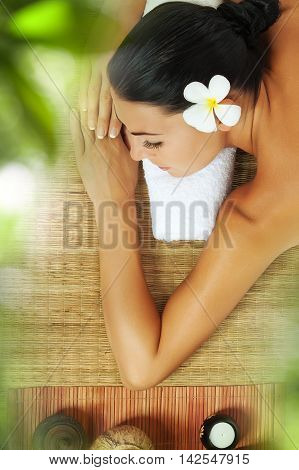 portrait of young beautiful woman relaxing in spa environment