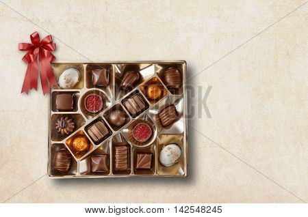 Close up view of chocolate candy on color background