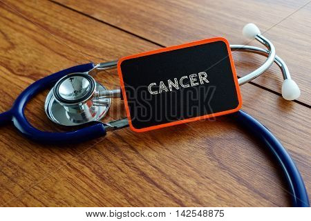 Medical Concept.word Cancer With Stethoscope On Wooden Table.