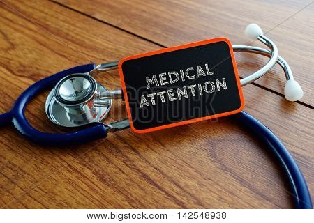 Medical Concept.word Medical Attention With Stethoscope On Wooden Table.