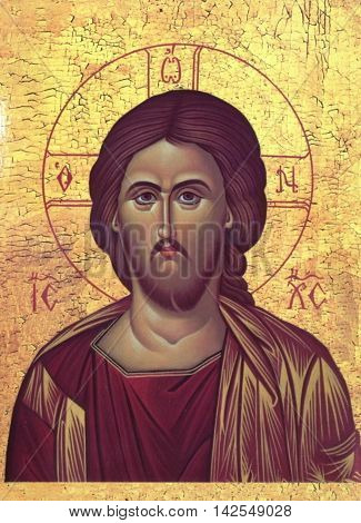 Icon of Jesus Christ on a yellow background