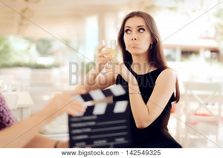 Upset Actress Holding a Glass in Movie Scene